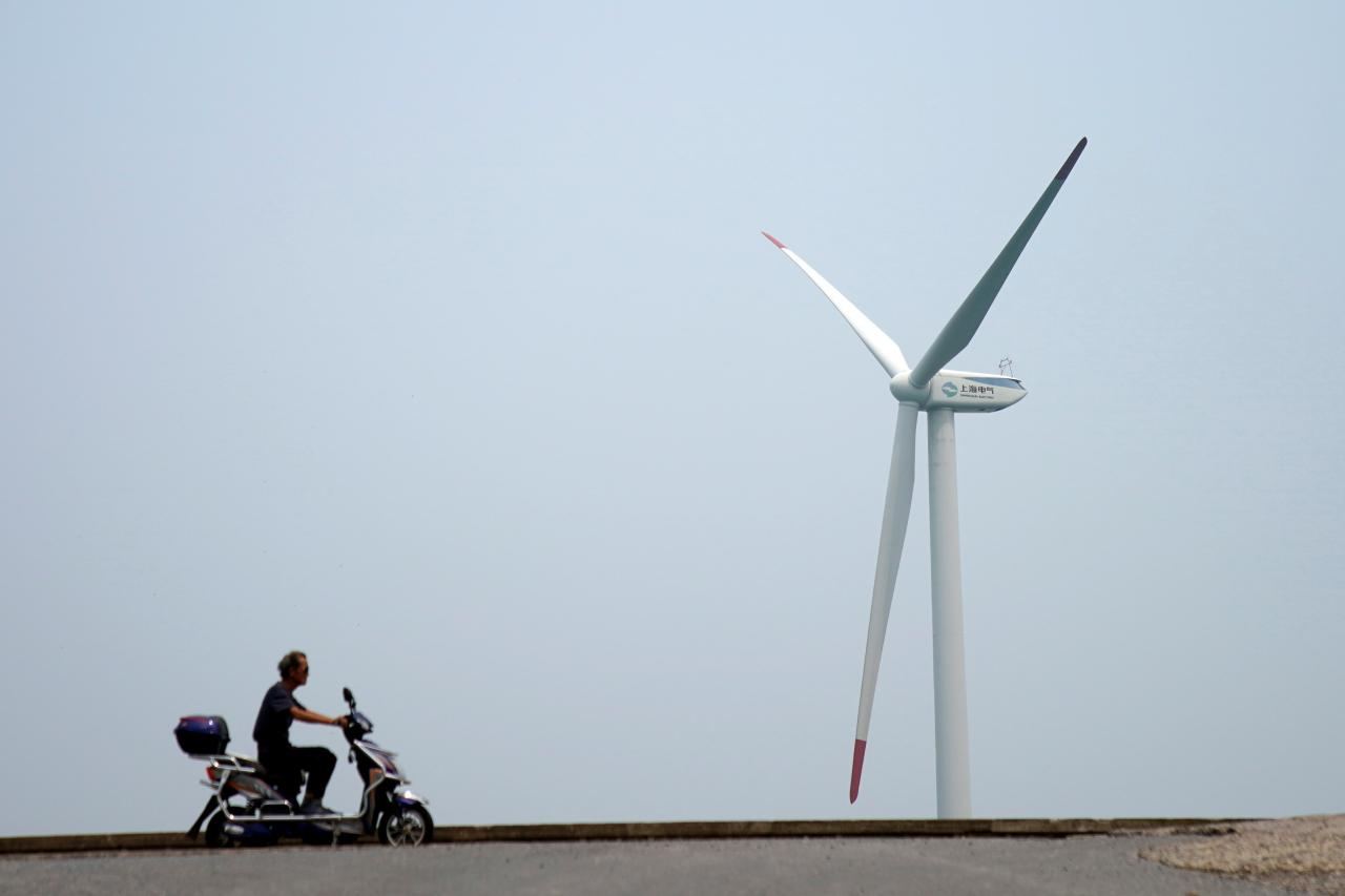 China launches subsidy-free solar, wind power after project costs fall