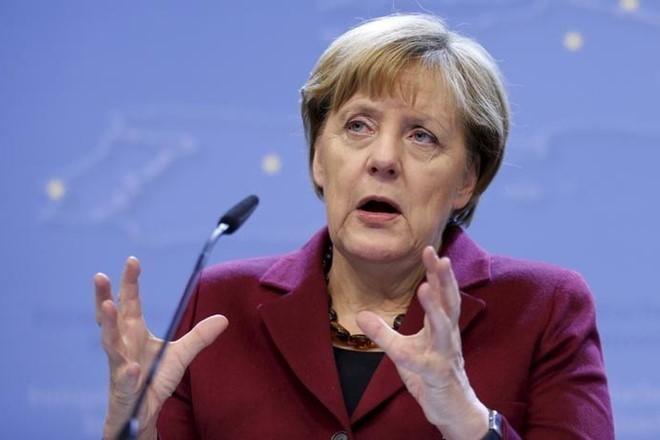German Economy: Angela Merkel seeks to heal rift over role of coal