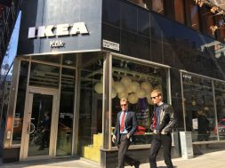 People walk past an IKEA kitchen showroom downtown Stockholm