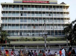 FILE-PHOTO-Commuters-walk-in-front-of-the-Bangladesh-central-bank-building-in-Dhaka