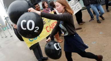 Activists protest against the carbon dioxide emissions trading in front of the World Congress Centre Bonn, the site of the COP23 U.N. Climate Change Conference, in Bonn