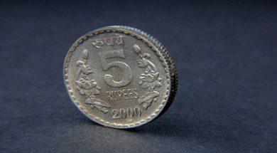 Rupee trades lower at 69.74 per dollar