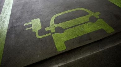 FILE PHOTO:  A sign is painted on a parking space for electric cars inside a car park in Hong Kong