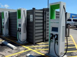 Electric vehicle charging stations are shown in the parking lot