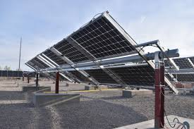 Global Techno-Economic Performance of Bifacial and Tracking Photovoltaic Systems