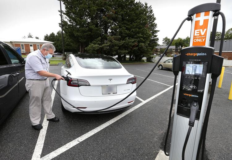 Bank installs electric vehicle charging station for public use
