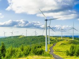 Wind turbines in fields on green hills