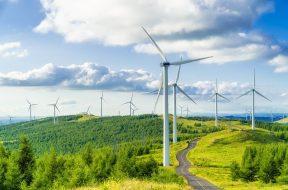 Wind turbines in fields on green hills