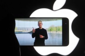 In this photo illustration a screenshot of Apple's CEO Tim