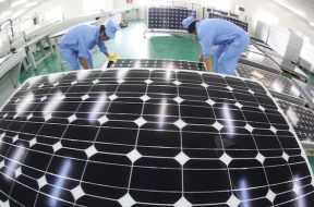 –File–Staff are producing solar cell modules in a factory in east Chinas Jiangsu province, 19 September 2010.China will double its solar capacity
