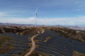 Wind turbines and solar panels are seen at a wind and solar power plant in Zhangjiakou