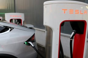 FILE PHOTO: A Tesla Supercharger station is seen in Dietikon