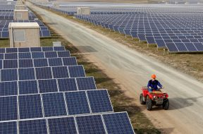An employee rides a quad bike during an inspection of a solar power station on the outskirts of Simferopol