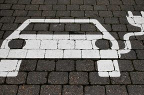 FILE PHOTO: A parking sign for electric vehicles is pictured in Gruenheide