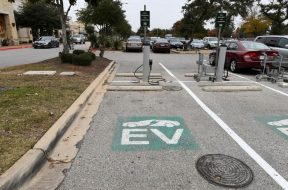 FILE PHOTO: An electric vehicle fast charging station is seen in the parking lot of a Whole Foods Market in Austin