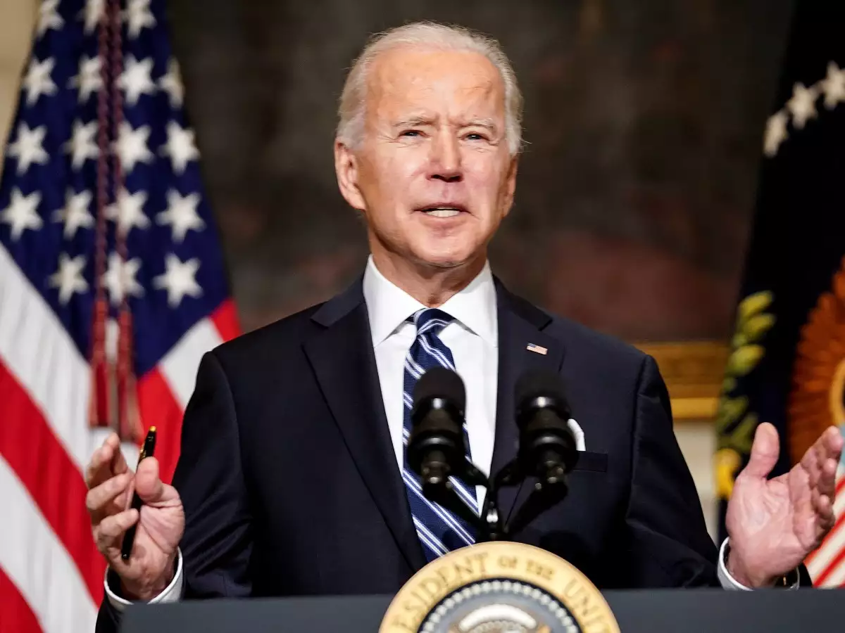 """President Biden sees """"win"""" for US in electric vehicle battery deal"""